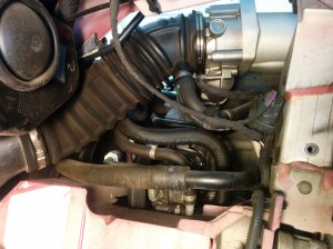 View of left hand side crankcase breather host connecton to throttle body on Aston Martin DB9