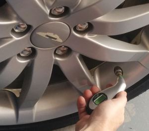 Checking the Tire Pressure on an Aston Martin DB9