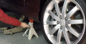 Lowering an Aston Martin DB9 Off Jack Stands