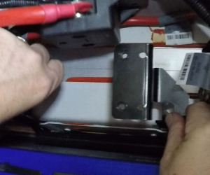 installing-the-battery-bracket-in-an-aston-martin-db9