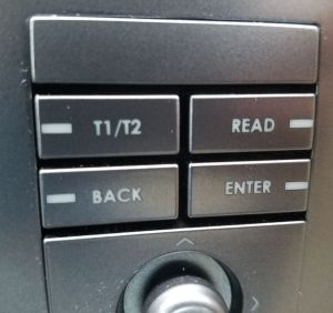 t1-t2-read-back-enter-button-cluster-on-entertainment-system-console-of-an-aston-martin-db9